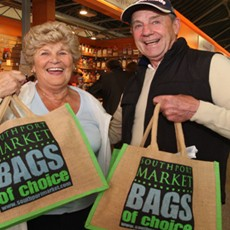Happy shoppers with southport market goody bags